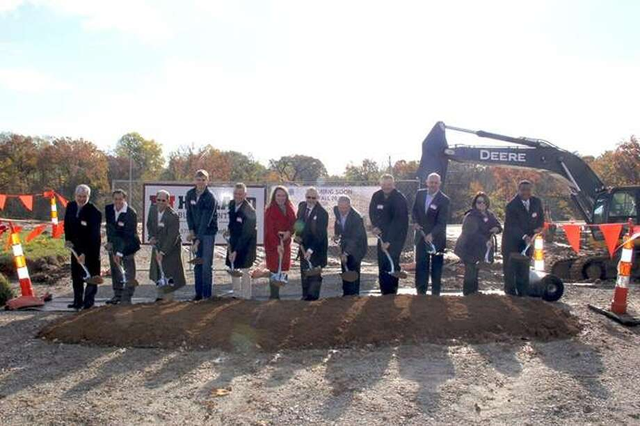 Fireside Financial representatives dig in at a groundbreaking ceremony at the development site of Whispering Heights on Nov. 6. This mixed-use community will include 153 luxury apartment homes and over 18,000 square feet of retail and restaurant space. It's set to open Fall 2019. Mike and Kristie Bailey of Fireside Financial are pictured, along with various members of the project team. Photo: For The Intelligencer