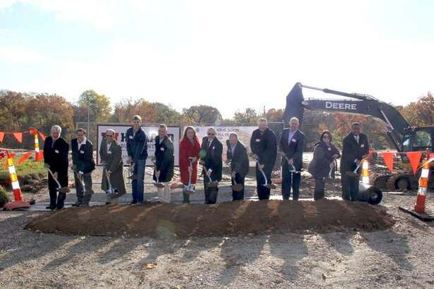 Fireside Financial representatives dig in at a groundbreaking ceremony at the development site of Whispering Heights on Nov. 6. This mixed-use community will include 153 luxury apartment homes and over 18,000 square feet of retail and restaurant space. It's set to open Fall 2019. Mike and Kristie Bailey of Fireside Financial are pictured, along with various members of the project team.