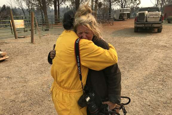 San Francisco Chronicle photographer Jessica Christian hugs Cathy Fallon, 62, on  Sun. Nov. 11, 2018. Fallon survived the Camp Fire but all her neighbors homes on Edgewood Lane in Paradise burned.