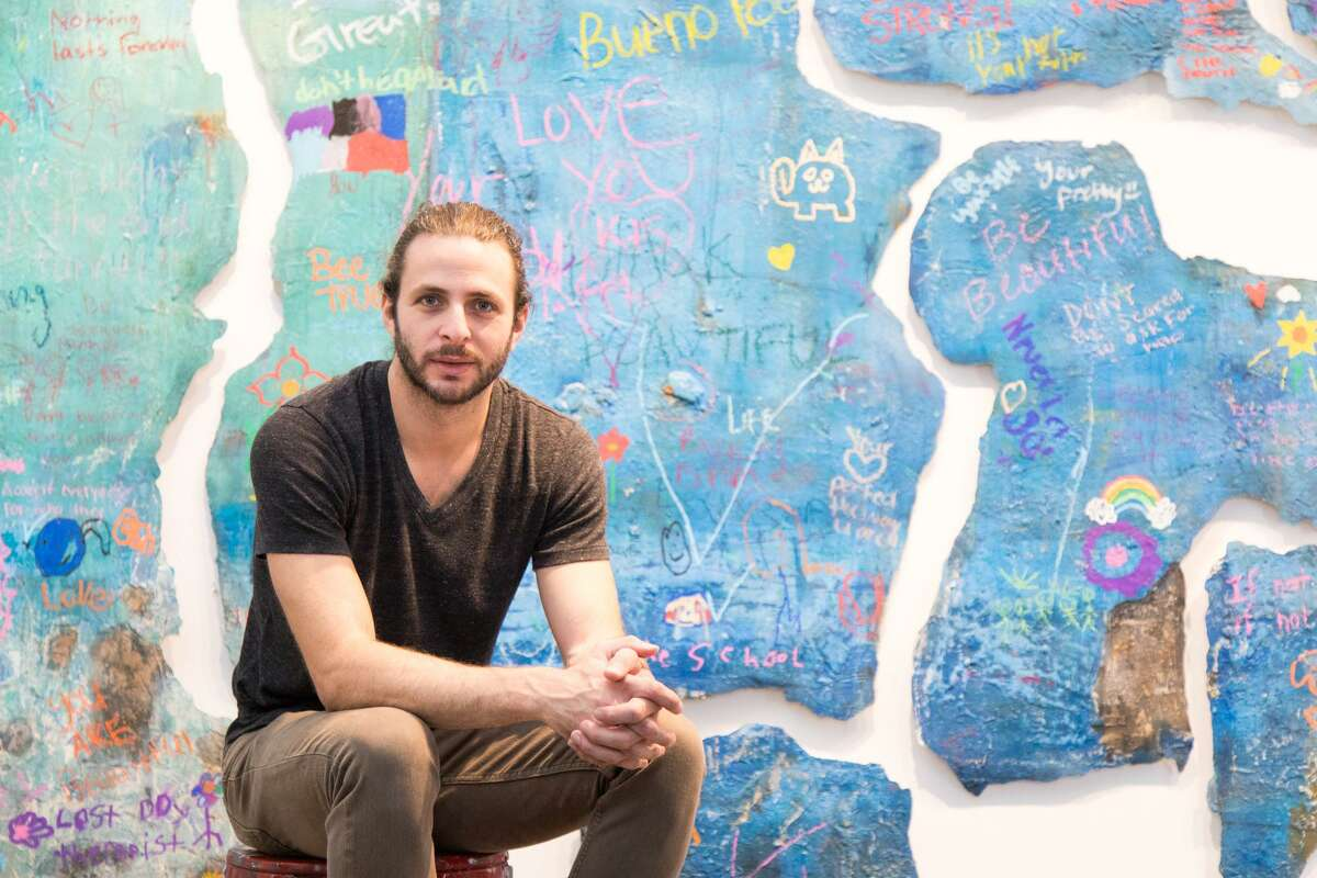 """Houston artist Justin Garcia uses art as therapy to help abused children through a program at the Children's Assessment Center. The project, ?""""Reflections of Growth,?"""" is part of Garcia's eight-piece series."""