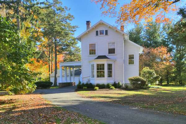 """The house at 401 Old Post Road used to be part of a larger house, at 415 Old Post Road, but was separated from that property in the 1970s and became a separate, free-standing house -- next door to its former """"parent."""" The 2,240-square-foot Colonial was built in 1880. The three-bedroom house has many classical features, including 11-foot-ceilings and period moldings, and sits at the end of a gated long driveway."""