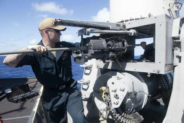 PACIFIC OCEAN - Fire Controlman 2nd Class Jacob Hathcote, from Houston, removes the gun assembly from the Phalanx close-in weapons system (CIWS) aboard the Arleigh Burke-class guided-missile destroyer USS Spruance (DDG 111). Spruance is currently conducting routine operations as part of Carrier Strike Group (CSG) 3 in the U.S. Pacific Fleet area of operations.
