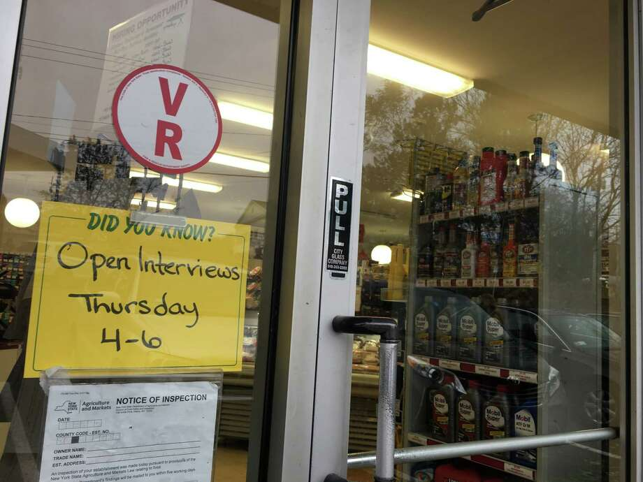 Signs outside of the Stewart's Shop at Albany Shaker and Everett Road invite the public to apply for work at the convenience store. Stewart's Shops starts employees at $12 an hour for pay, higher than New York'sminimumwagein 2019, when it rises to $11.10. Photo: Diego Mendoza-Moyers