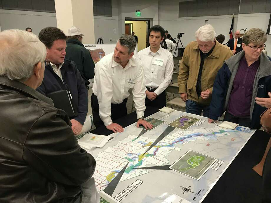 Erwin Burden, project manager for Harris County Flood Control District, discusses a watershed with citizens during theLittle Cypress Creek Frontier Program Community Meeting held Nov. 14 Photo: Chevall Pryce