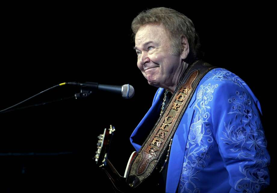 "In this April 13, 2012 photo, Roy Clark smirks after joking around during his 79th birthday show at The Joint in the Hard Rock Hotel and Casino in Catoosa, Okla. Clark, the guitar virtuoso and singer who headlined the cornpone TV show ""Hee Haw"" for nearly a quarter century and was known for such hits as ""Yesterday When I was Young"" and ""Honeymoon Feeling,"" has died. He was 85. Publicist Jeremy Westby said Clark died Thursday, Nov. 15, 2018, due to complications from pneumonia at home in Tulsa, Okla. (Tulsa World via AP, File) Photo: Associated Press"