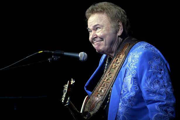 "In this April 13, 2012 photo, Roy Clark smirks after joking around during his 79th birthday show at The Joint in the Hard Rock Hotel and Casino in Catoosa, Okla. Clark, the guitar virtuoso and singer who headlined the cornpone TV show ""Hee Haw"" for nearly a quarter century and was known for such hits as ""Yesterday When I was Young"" and ""Honeymoon Feeling,"" has died. He was 85. Publicist Jeremy Westby said Clark died Thursday, Nov. 15, 2018, due to complications from pneumonia at home in Tulsa, Okla. (Tulsa World via AP, File)"