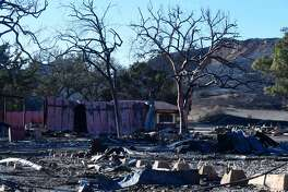 "The Paramount Ranch, where the television show ""Westworld"" was filmed, is left in ruins after the Woolsey fire on November 12, 2018 in Agoura Hills, California. - Thousands of firefighters spent a fifth day digging battle lines to contain California's worst ever wildfire as the wind-whipped flames cleaved a merciless path through the state's northern hills, leaving death and devastation in their wake. The Camp Fire -- in the foothills of the Sierra Nevada mountains north of Sacramento -- has killed 29 people, matching the state's deadliest ever brush blaze 85 years ago. More than 200 people are still unaccounted for, according to officials. (Photo by Robyn Beck / AFP) (Photo credit should read ROBYN BECK/AFP/Getty Images)"