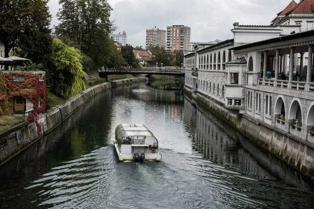 A sightseeing boat travels along the Ljubljanica River in Ljubljana, Slovenia, on Oct. 10, 2016.MUSR CREDIT: Bloomberg photo by Akos Stiller