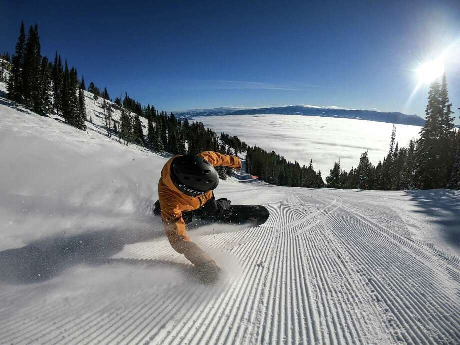 A snowboarder enjoys the solitude on a steep descent at Jackson Hole Mountain Resort in Wyoming. (Jackson Hole Mountain Resort) Photo: Jackson Hole Mountain Resort / Chicago Tribune