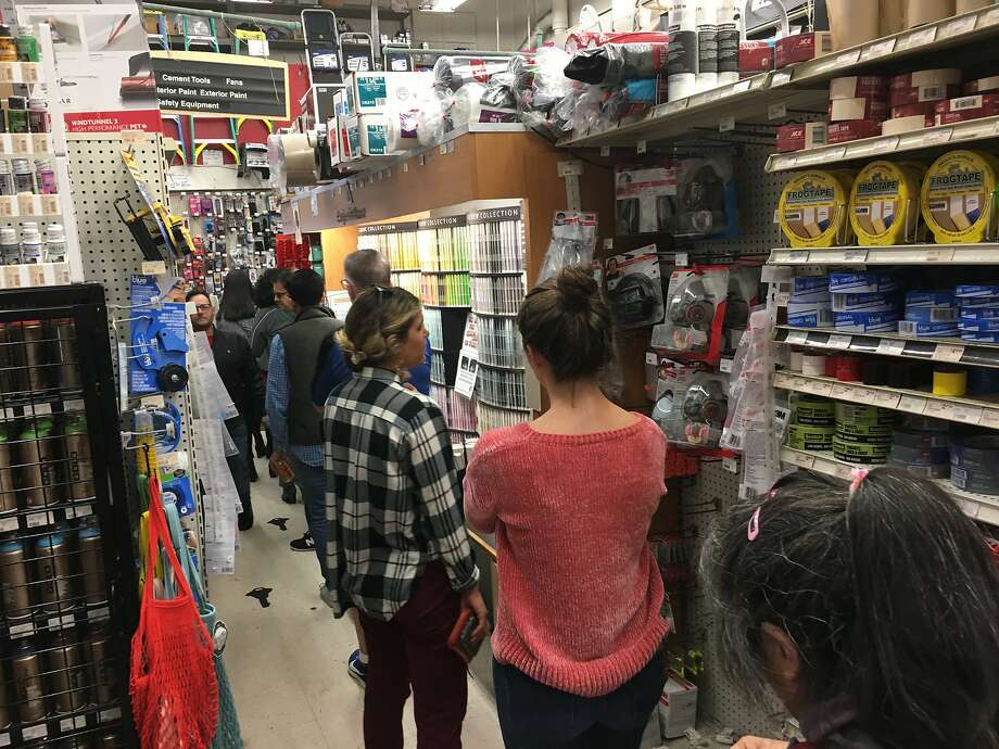 A line for air masks and respirators extends throughout the store at Cole Hardware on Fourth Street on Thursday, Nov. 15 in San Francisco, Calif. Photo: Spud Hilton / The Chronicle