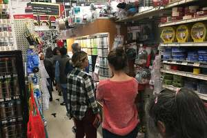 A line for air masks and respirators extends throughout the store at Cole Hardware on Fourth Street in San Francisco on Thursday, Nov. 15 in San Francisco, Calif.