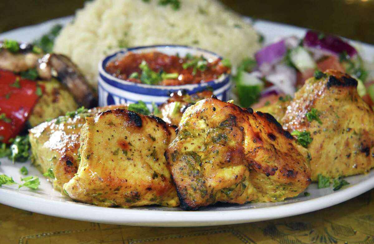 Chicken kebab, couscous, and Harissa sauce at Marrakesh - Authentic Moroccan Cuisine at the Clifton Park Center Mall Thursday Nov. 8, 2018 in Clifton Park, NY. (John Carl D'Annibale/Times Union)