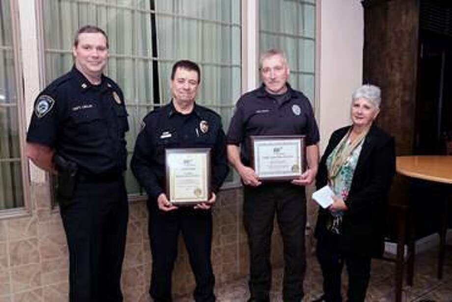 At AAA's 9th annual Community Traffic Safety Awards lunch recently at Testo's in Bridgeport, AAA Public Affairs Manager Fran Mayko, right, presented awards, from left, to Capt. John Lawlor, Chief Ray Osborne and Officer T. Court Isaac, of the Darien Police Department. Photo: Contributed Photo