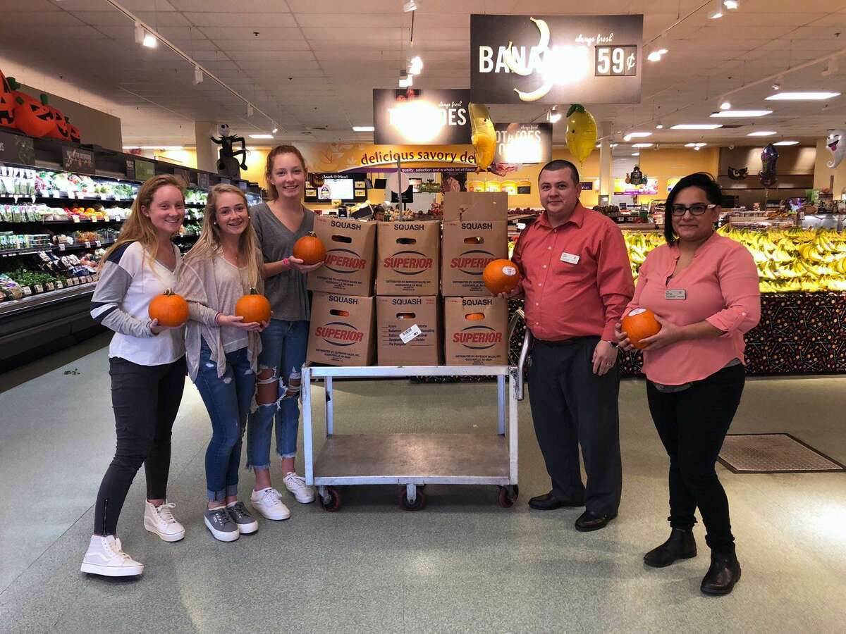 The Depot Student Governing Board recently held a Pumpkin Painting event for younger children at The Depot Youth Center. Manager Roger Fajardo, of Goodwives Stop and Shop, donated 60 pumpkins to the cause. From left, Chairmen Lizzie Canelli, Lila Karl, Sara McCarthy; Fajardo, and assistant manager Lina Restrepo.