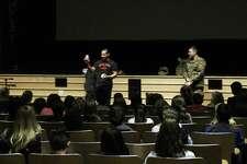 John Lettera, veteran, and Charles Foley, a veteran, talking to students at Saxe Middle School. Taken Nov. 12.