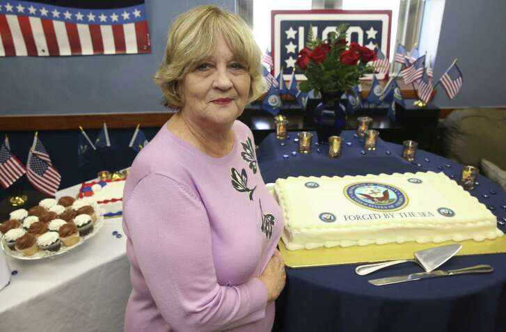 Shirley Logan Gustas, 71, a long-time United Service Organizations volunteer, celebrates the U.S. Navy's 243rd birthday at the Houston Military Entry Processing Station. Gustas started volunteering at USO in 2005, and she has been hosting and donating birthday recognitions for all branches of the military.