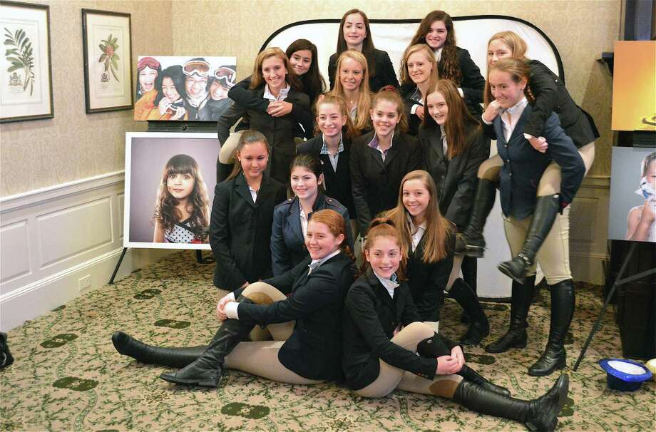 "Above, members of the teen leadership program pose for a picture at the ""Jump for Joy"" gala for the New Canaan Mounted Troop on Nov. 10 at Wee Burn Country Club in Darien. Photo: Jarret Liotta / For Hearst Connecticut Media / Darien News Freelance"