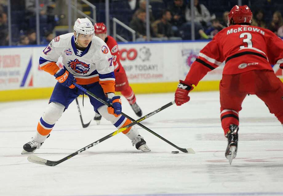 The Sound Tigers' Michael Dal Colle, left, looks for room against the Charlotte Checkers on Nov. 11 at the Webster Bank Arena in Bridgeport. Photo: Brian A. Pounds / Hearst Connecticut Media / Connecticut Post