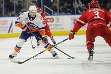 The Sound Tigers' Michael Dal Colle, left, looks for room against the Charlotte Checkers on Nov. 11 at the Webster Bank Arena in Bridgeport.