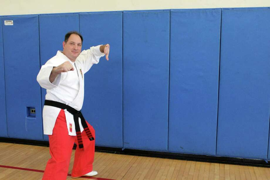James Gombos, martial arts teacher, poses at the Darien Arts Center on Oct. 23. Photo: Lynandro Simmons /Hearst Connecticut Media /