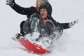 Children seemed to really enjoy their ride down the hill in Alton's Haskell Park Thursday morning after the area received it's first major snowfall of the season, and one of the earliest in history. At least six inches fell on Alton and nearby communities overnight and through about 11 a.m. Thursday. No major problems were reported on area roads and most area schools were closed Thursday.