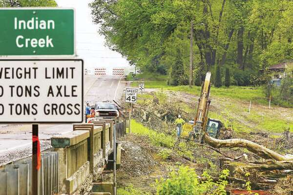 In this photo from in May, the bridge over Indian Creek at Illinois Route 143 was closed as workers began the process of constructing a new bridge. Now, after more than six months, the oft-used road is once again open to traffic.