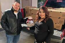 Mike and Monica Valenzuela are shown in this photo before their 250 turkey giveaway on Thursday.