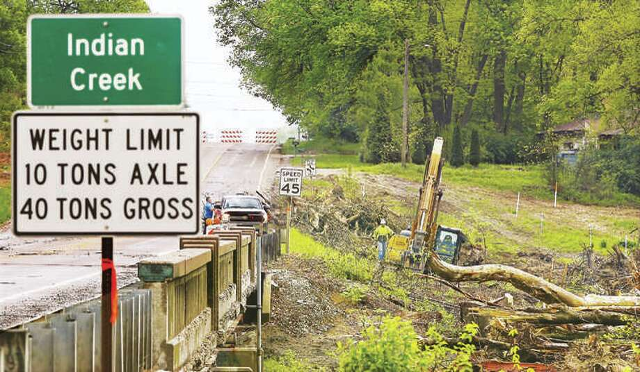In this photo from in May, the bridge over Indian Creek at Illinois Route 143 was closed as workers began the process of constructing a new bridge. Now, after more than six months, the oft-used road is once again open to traffic. Photo: John Badman | Hearst Illinois