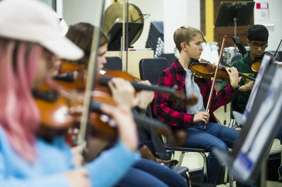 Dow High students tune their instruments during orchestra class on Thursday, Nov. 15, 2018. Orchestra students, along with choirs, bands, pom squads and more will be performing during the school's annual variety show, RenFair, at 7 p.m. Saturday, Nov. 17 at Midland Center for the Arts. (Katy Kildee/kkildee@mdn.net) Photo: (Katy Kildee/kkildee@mdn.net)
