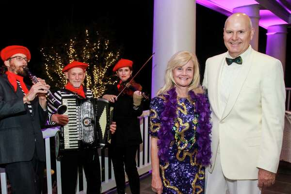 EMBARGOED FOR REPORTER UNTIL NOV. 15 Cecily and Rick Burleson, with the Gypsy Dance Theatre band, at the Bayou Preservation New Orleans style gala.