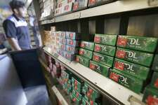 CORRECTS DATE OF ANNOUNCEMENT TO NOVEMBER, NOT MAY - FILE - This May 17, 2018 file photo shows packs of menthol cigarettes and other tobacco products at a store in San Francisco. On Thursday, Nov. 15, 2018, FDA Commissioner Dr. Scott Gottlieb pledged to ban menthol from cigarettes, in what could be a major step to further push down U.S. smoking rates. (AP Photo/Jeff Chiu)
