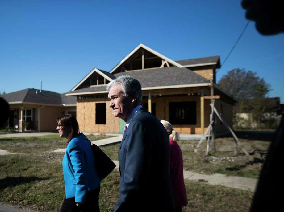 Federal Reserve Chairman Jerome Powell, center, walks a Houston Habitat for Humanity build site during a visit to the Fifth Ward, Thursday, Nov. 15, 2018, in Houston. Photo: Marie D. De Jesús, Staff Photographer / © 2018 Houston Chronicle