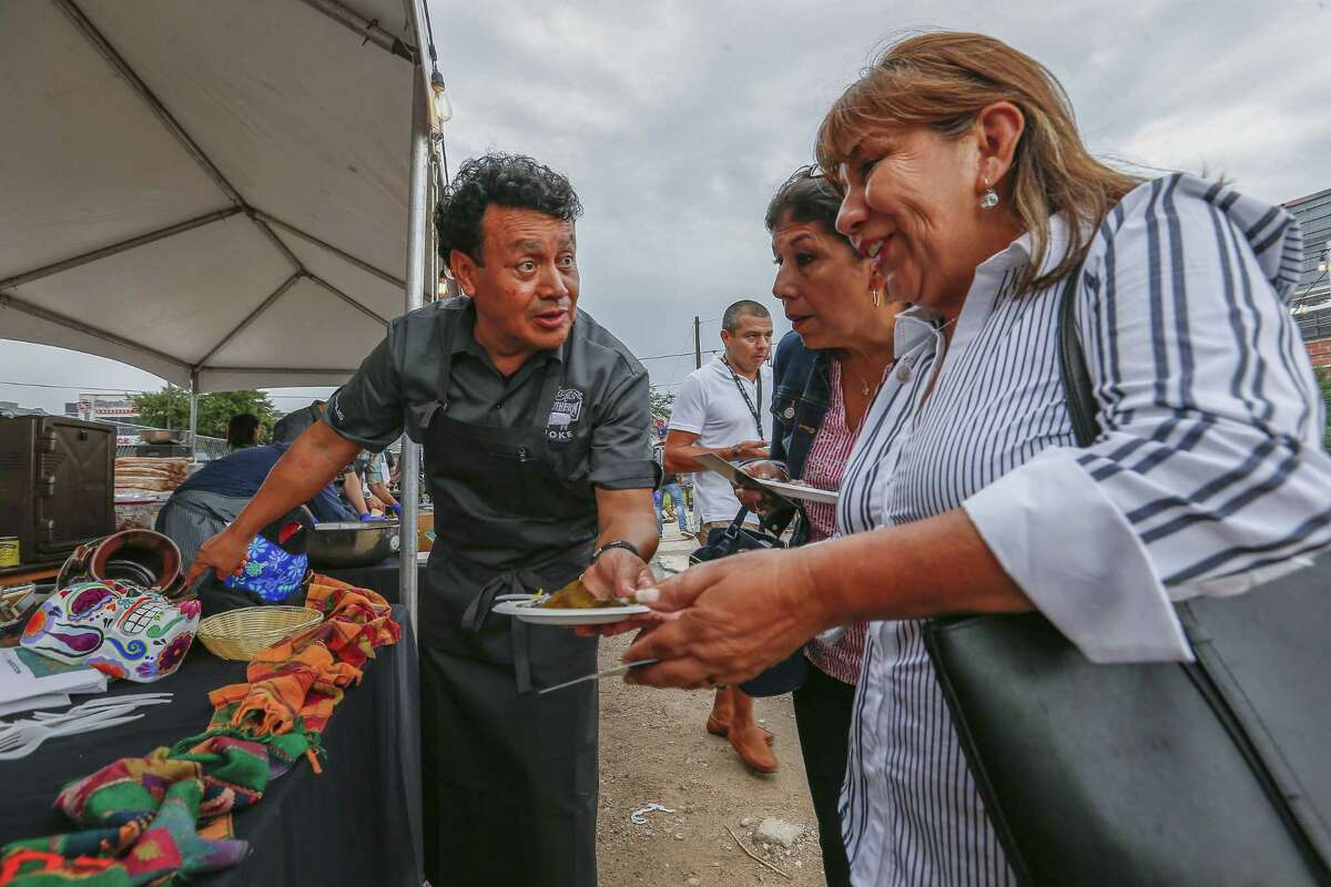 Chef Hugo Ortega hands out huitlacoche tamales at the 2018 Southern Smoke culinary event.
