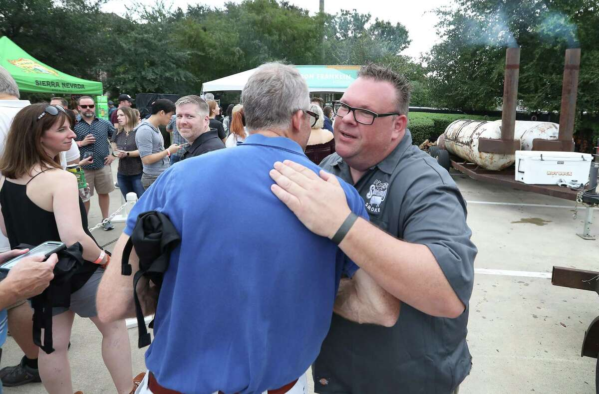 Southern Smoke founder Chris Shepherd receives a hug from an attendee at Southern Smoke in 2018.