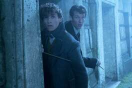 """This image released by Warner Bros. Pictures shows Eddie Redmayne, left and Callum Turner in a scene from """"Fantastic Beasts: The Crimes of Grindelwald."""" (Liam Daniel/Warner Bros. Pictures via AP)"""