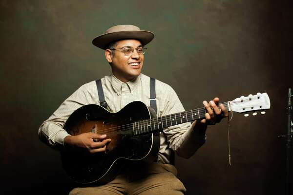 Dom Flemons, a founding member of the Carolina Chocolate Drops, is performing at Fernando Pinto Presents' East Rock Concert Series at the mActivity Coffee Bar.