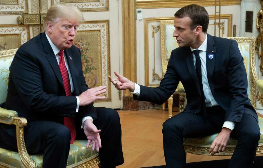 President Donald Trump and French President Emmanuel Macron talk Nov. 10 in Paris. Macron later criticized nationalism, seen as a rebuke of Trump. Photo: SAUL LOEB /AFP /Getty Images / AFP or licensors
