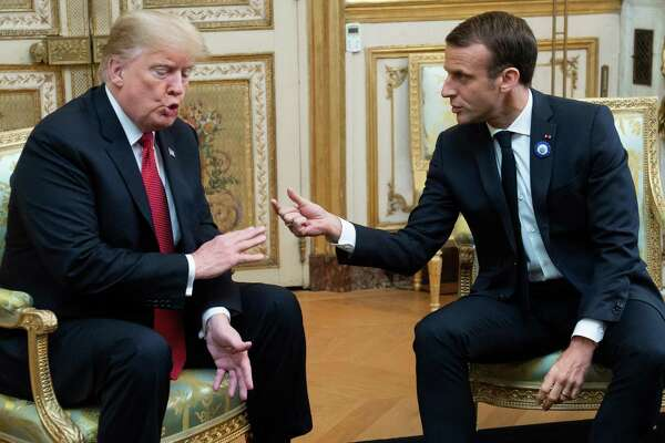 President Donald Trump and French President Emmanuel Macron talk Nov. 10 in Paris. Macron later criticized nationalism, seen as a rebuke of Trump.