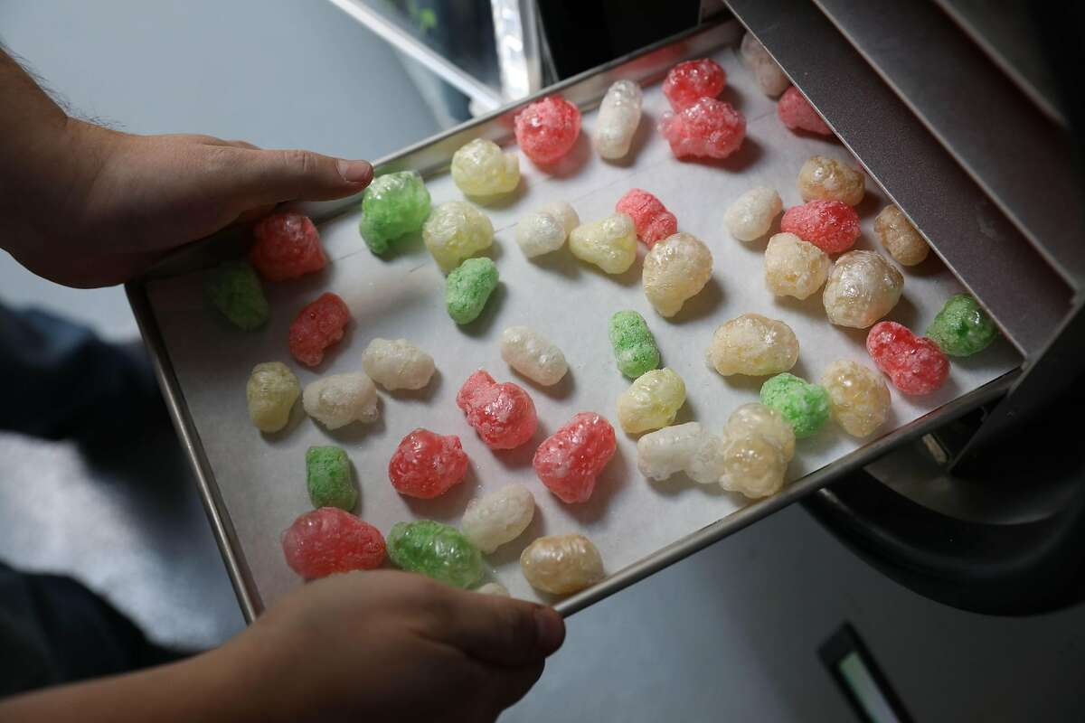 Tinker Kitchen owner Dan Mills removes freeze dried gummy bears from a freeze dryer at Tinker Kitchen on Thursday, November 14, 2018 in San Francisco, Calif.