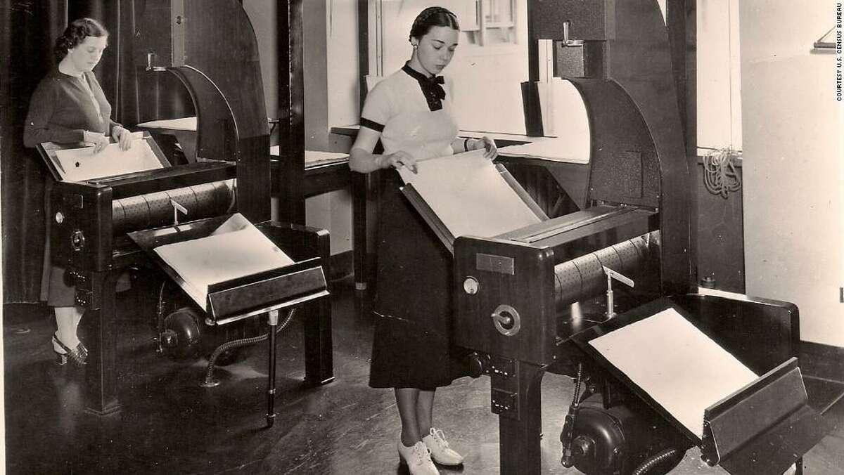 Census Bureau employees process microfilm records, circa 1940.