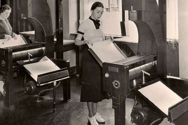 Census Bureau employees process microfilm records, circa 1940.