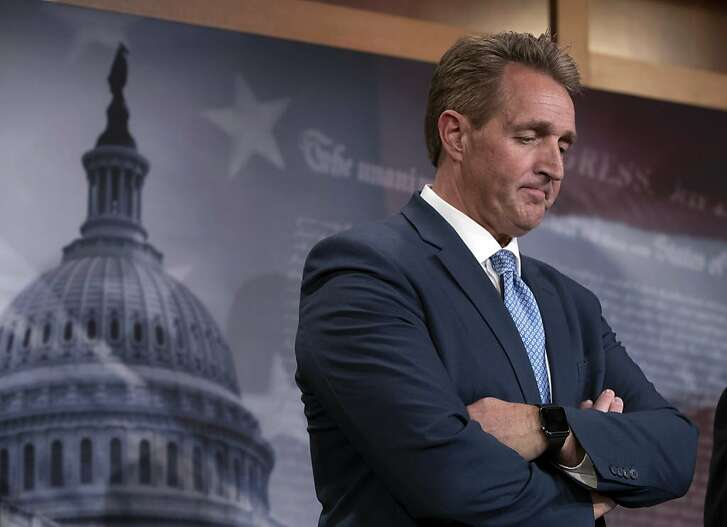 I this Thursday, July 19, 2018, Sen. Jeff Flake, R-Ariz., holds a news conference on the U.S. intelligence community findings that Russia interfered in the 2016 election, at the Capitol in Washington. Flake and Sen. Chris Coons, D-Del., are calling for a floor vote on legislation to protect Special Counsel Robert Mueller in the wake of former Attorney General Jeff Sessions's forced resignation by President Donald Trump and replacing him with Matthew Whitaker, a Trump loyalist. (AP Photo/J. Scott Applewhite, file)
