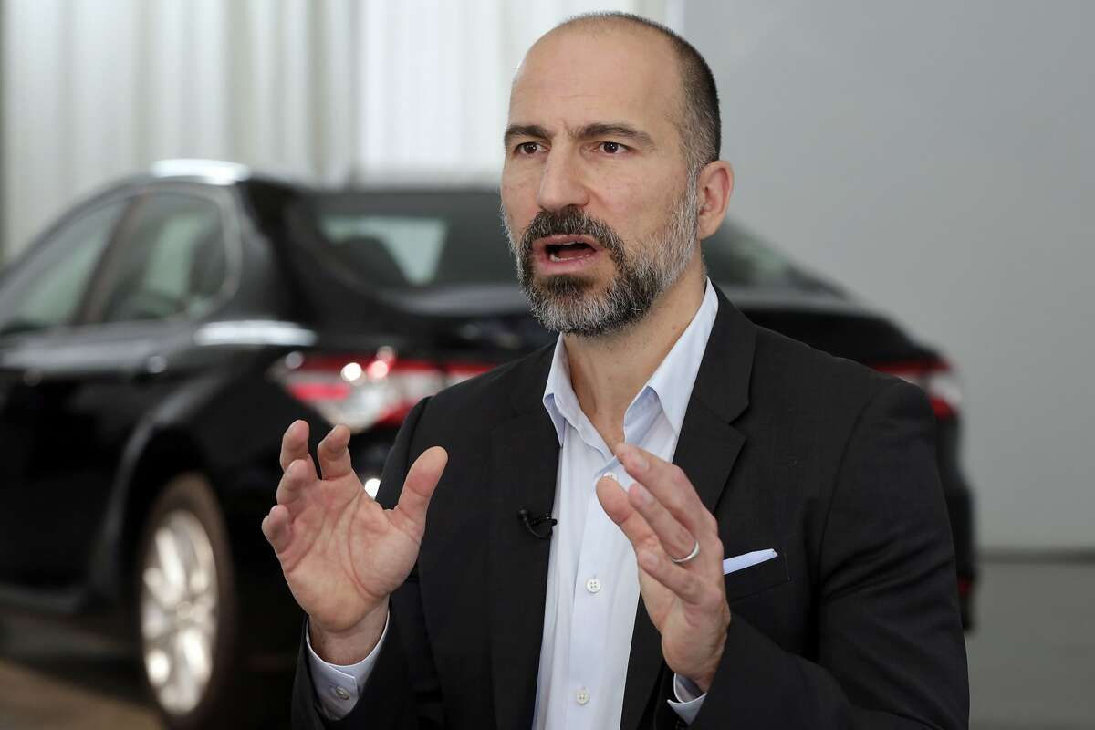 FILE- In this Sept. 5, 2018, file photo Uber CEO Dara Khosrowshahi is interviewed after the company's unveiling of the new features, in New York. Uber's net loss widened by $177 million in the third quarter as the ride-hailing giant continued to invest ahead of a planned public stock offering next year. (AP Photo/Richard Drew, File)