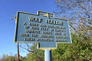 A historical marker near Wolf Hollow notes some of the ravine's highlights. (Gillian Scott / Special to the Times Union)