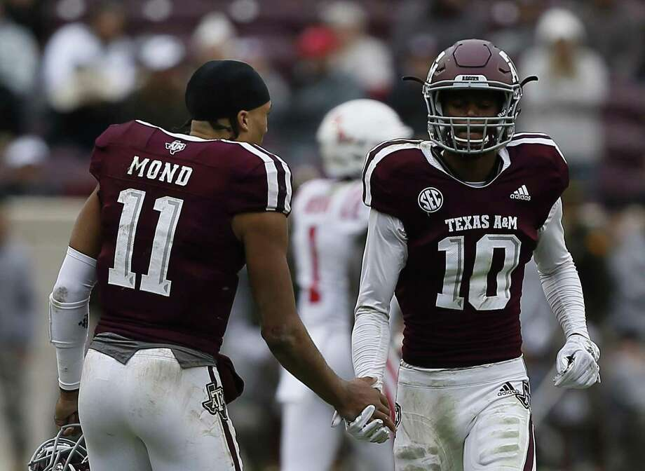 Myles Jones (10)of the Texas A&M Aggies receives a handshake from Kellen Mond (11) after he was ejected from the game for targeting in the fourth quarter against the Mississippi Rebels at Kyle Field on November 10, 2018 in College Station, Texas. Photo: Bob Levey, Stringer / Getty Images / 2018 Getty Images