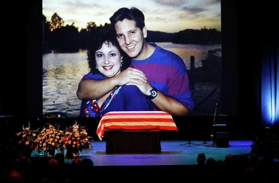 A family photo during a video montage of Ventura County Sheriff Sgt. Ron Helus with his wife Karen years ago during Memorial service for Sgt. Helus at Calvary Community Church in Westlake Village, Calif., Thursday, Nov. 15, 2018. Sgt. Helus was one of twelve victims of the Borderline Bar & Grill mass shooting in Thousand Oaks last week. (Al Seib /Los Angeles Times via AP, Pool) Photo: Al Seib, AP / © Los Angeles Times