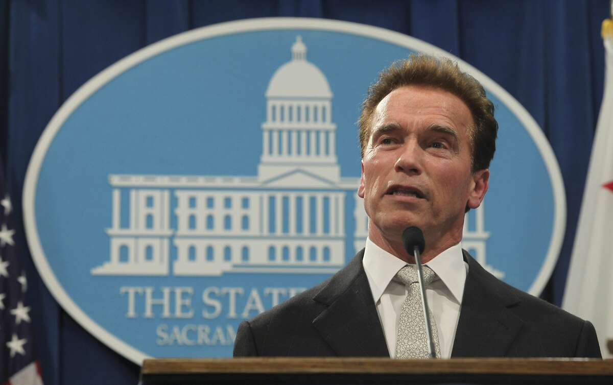 Gov. Arnold Schwarzengger announces that he will sign the newly approved state budget Friday, during a Capitol news conference in Sacramento, Calif., Thursday, Feb. 19, 2009. Lawmakers worked through the night to reach a compromise on the spending plan that includes tax increase, spending cuts and borrowing to ease an expected $42 billion budget deficit.(AP Photo/Rich Pedroncelli)