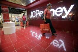Customers leave the new JC Penney store in the Manhattan Mall with their purchases during the grand opening, Friday, July 31, 2009 in New York. (AP Photo/Mary Altaffer)
