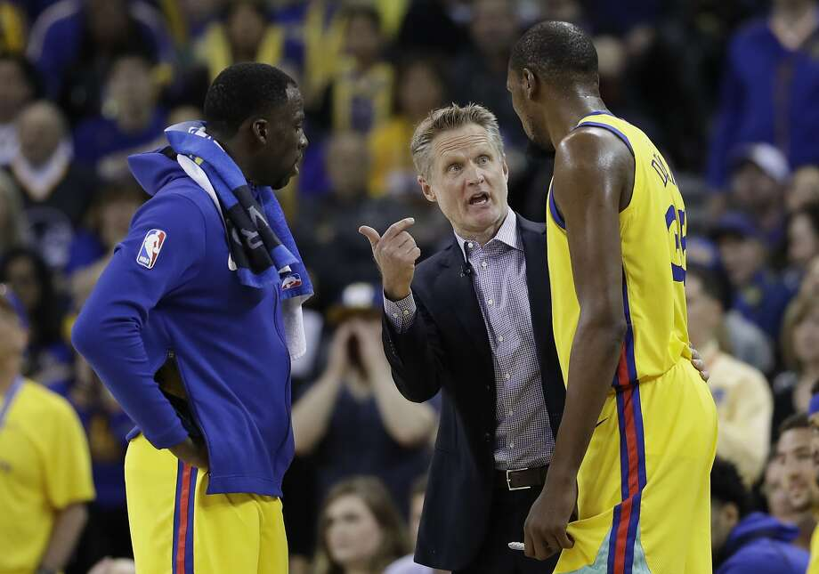 Golden State Warriors head coach Steve Kerr, center, talks to Kevin Durant, right, and Draymond Green during the second half of an NBA basketball game against the Oklahoma City Thunder Saturday, Feb. 24, 2018, in Oakland, Calif. (AP Photo/Marcio Jose Sanchez) Photo: Marcio Jose Sanchez / AP