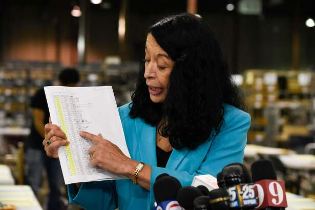 Susan Bucher holds up the vote tallies as she speaks with the media regarding not meeting the original midterm count deadline, creating a hand count starting in the afternoon at Palm Beach County Supervisor of Election Warehouse on November 15, 2018 in West Palm Beach, Florida. - Final results have yet to be declared in multiple races following last week's midterm polls, with tense recounts underway in Florida. (Photo by Michele Eve Sandberg / AFP)MICHELE EVE SANDBERG/AFP/Getty Images